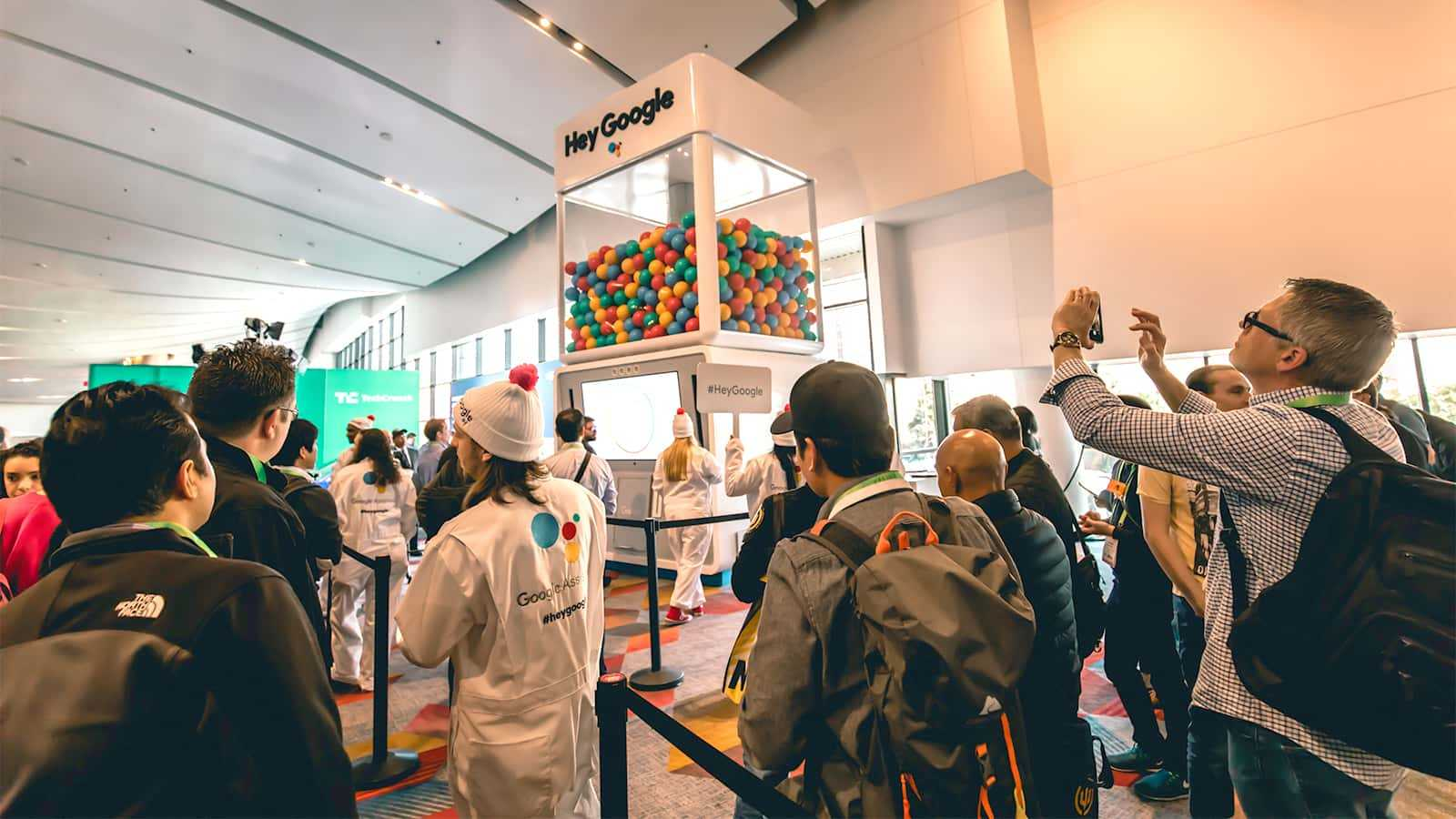 Attendees in line at a Google Assistant Gumball Machine at the Google CES 2018 experience.