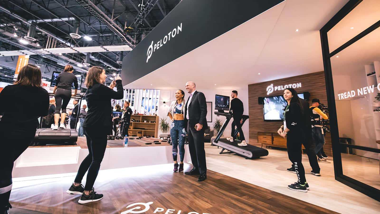 Attendees take selfies with Peloton instructors at the Peloton CES 2018 experience.