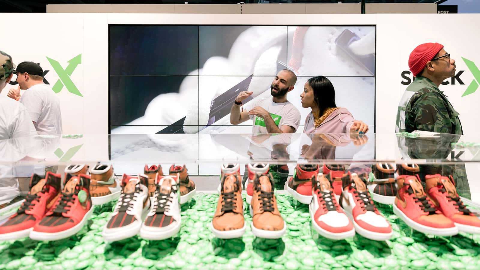 Brand ambassador instructs at the StockX ComplexCon 2017 booth.