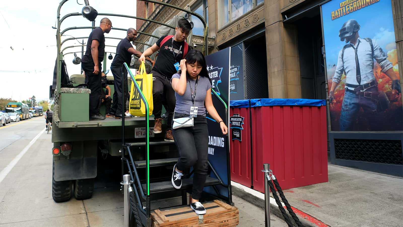 Twitch attendees disembark the PUBG transport truck.