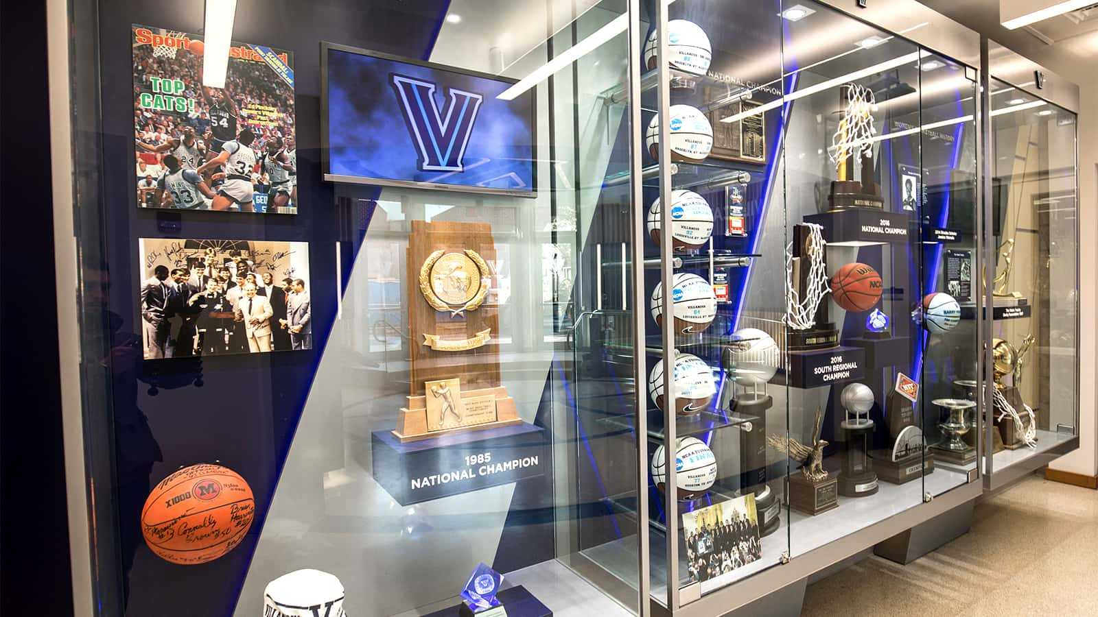 Close-up view of the Wildcat Basketball trophy case in the rear of the atrium of the Villanova Davis Center.