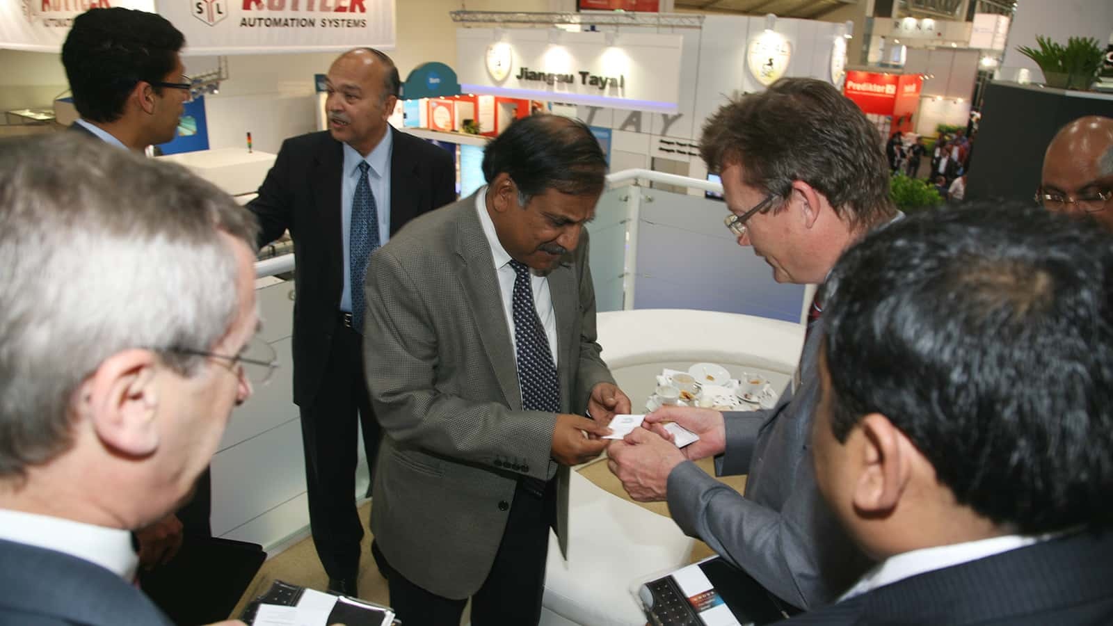 An interaction with the attendees of the the Applied Materials Intersolar trade show exhibit in 2011.
