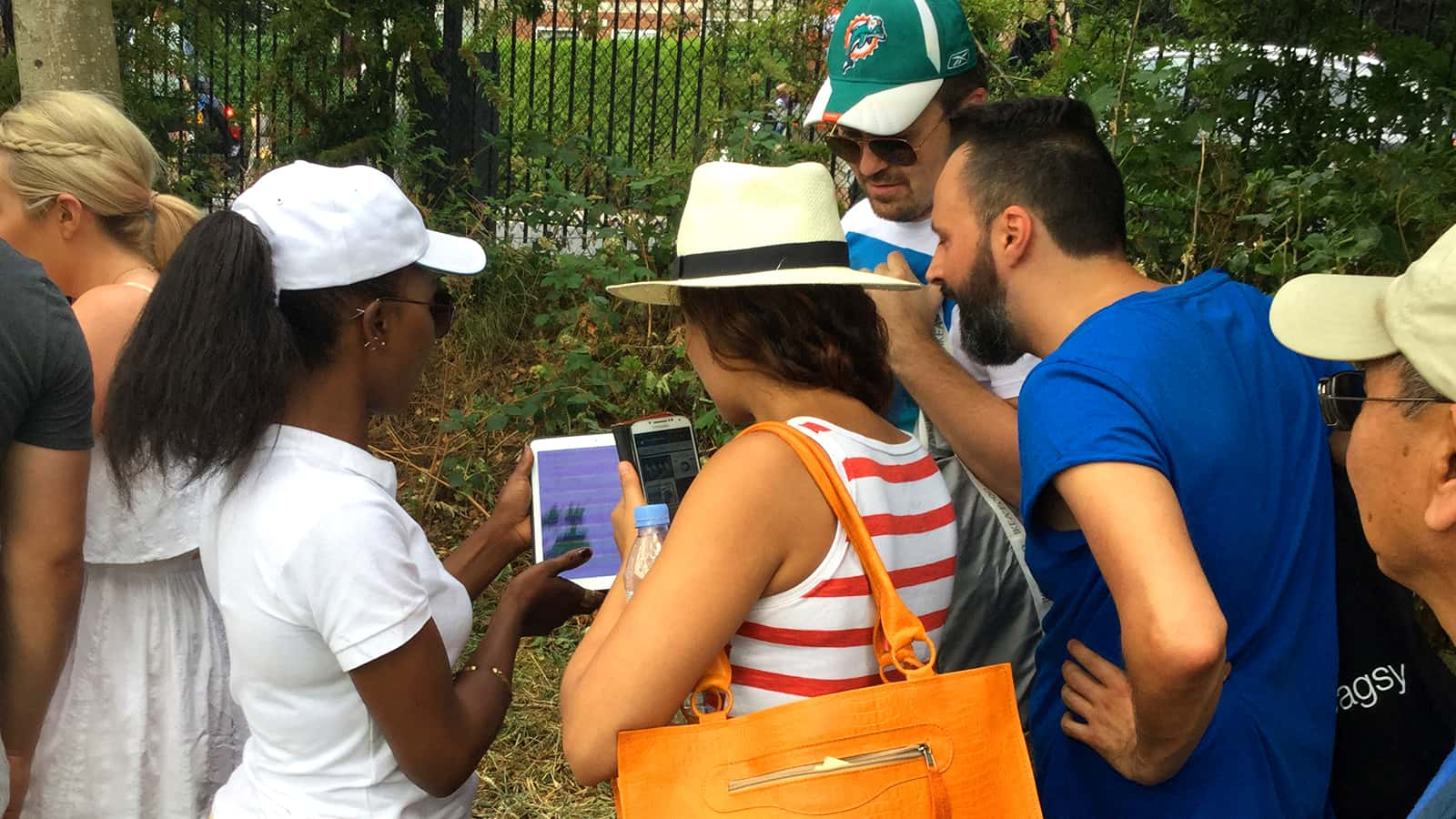 Tennis fans interacting with the Twitter Wimbledon Queue digital experience 2015.