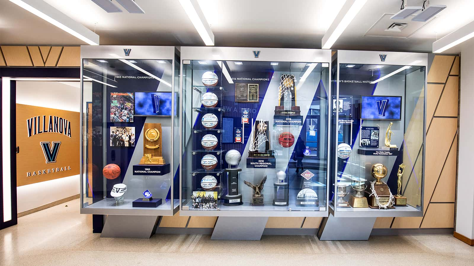 Wildcat Basketball trophy case in the rear of the atrium of the Villanova Davis Center.