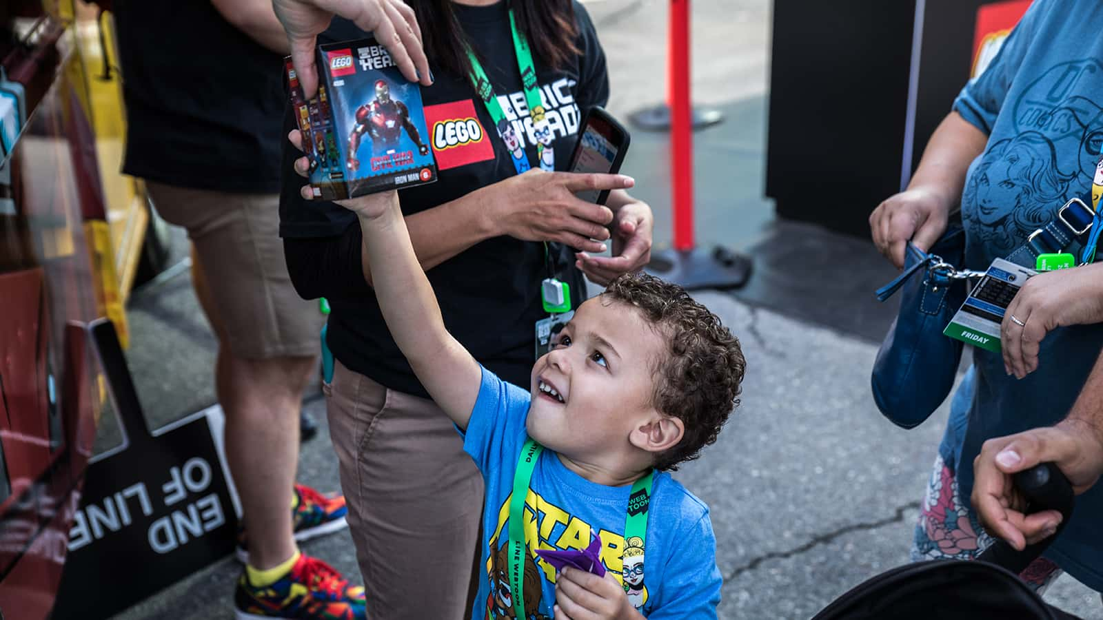 A little fan gets his favorite BrickHeadz at the LEGO Food Truck parked in the LEGO Star Wars BrickHeadz zone at New York Comic Con 2017.