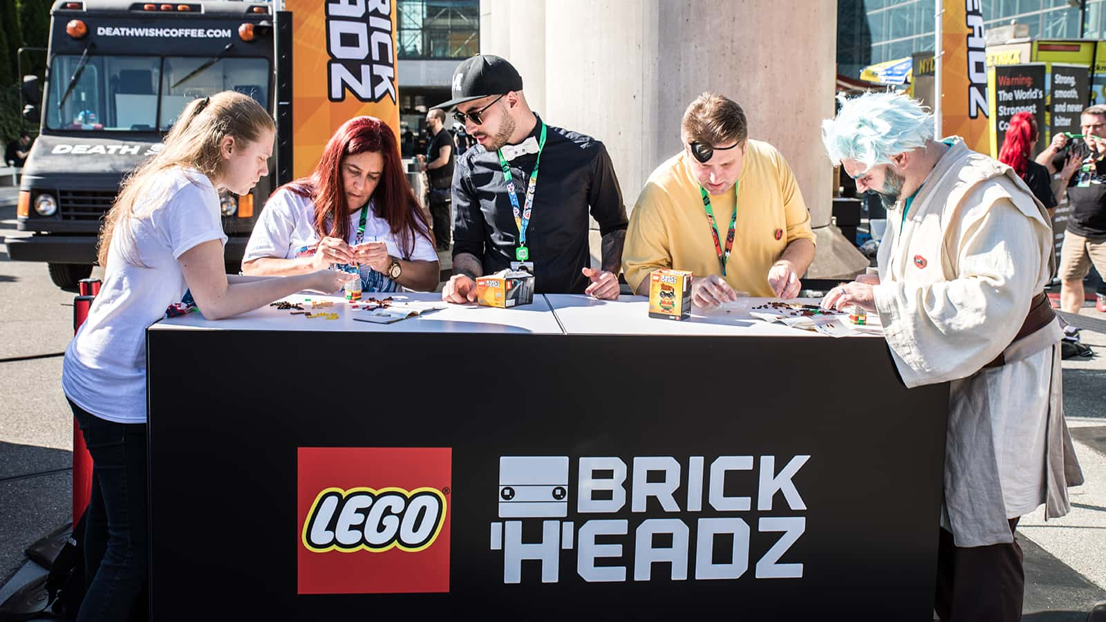 Marco Bessa, Senior Designer Super Heros/BrickHeadz design, conducts build challenges on site at the LEGO Star Wars BrickHeadz zone at New York Comic Con 2017.